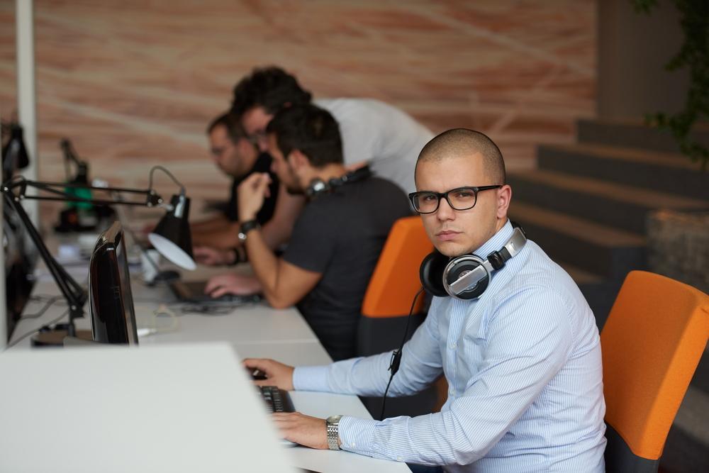 startup business, software developer working on computer at modern office-1